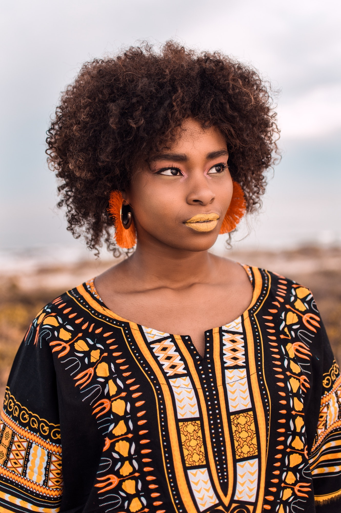 Young beautiful African woman, wearing African print design clothes