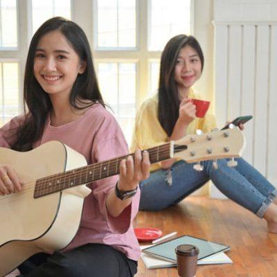 teenage-girls-are-singing-and-playing-guitars-they-NJUHDBF.jpg